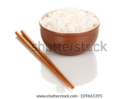Bowl of rice and chopsticks isoalted on white