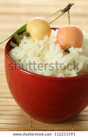 Bowl of rice served with little apples