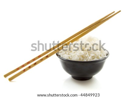 Bowl of rice with chopsticks isolated over white