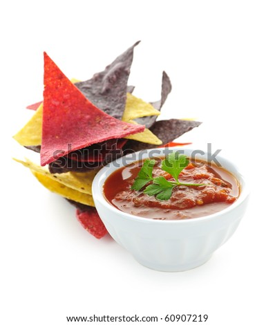 Bowl of salsa with colorful tortilla chips isolated on white background