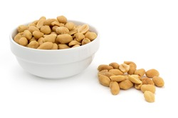 bowl of shelled peanuts on white background