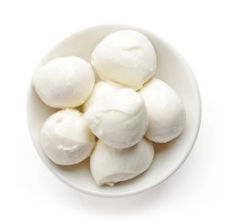 Bowl of small mozzarella balls isolated on white background, top view