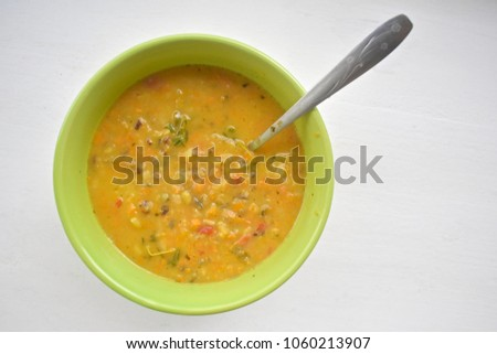 Bowl of soup on white wood table top background #1060213907