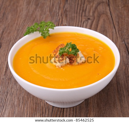bowl of soup with croutons and parsley