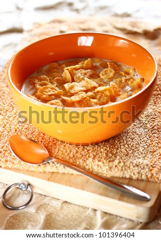bowl of sugar-coated corn flakes