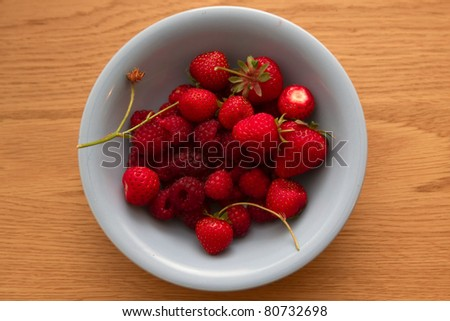 Bowl of summer fruit on a wooden table