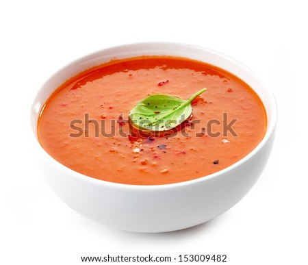 Bowl of tomato soup isolated on a white background