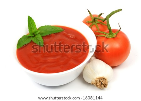 Bowl of tomato soup with two tomatoes and garlic isolated on white - stock photo