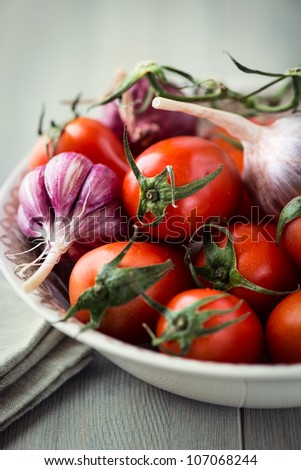 Bowl of tomatoes, garlic and onion #107068244
