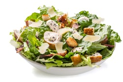Bowl of Traditional Caesar Salad with Chicken and Bacon isolated on White Background