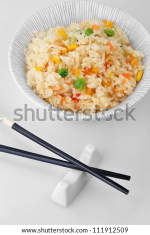 bowl of vegetable fried rice and chopstick. chinese cuisine