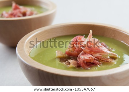 bowl of vegetable soup with ham and olive oil