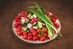 bowl of vegetables on wooden background
