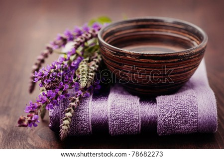 bowl of water and fresh sage - beauty treatment