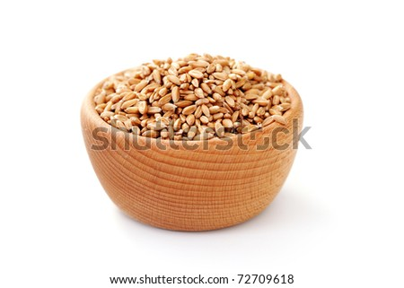 bowl of wheat grain on white background - food and drink