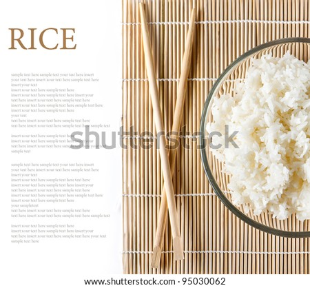 bowl of white steamed rice with chopsticks on bamboo mat. with place for your sample text