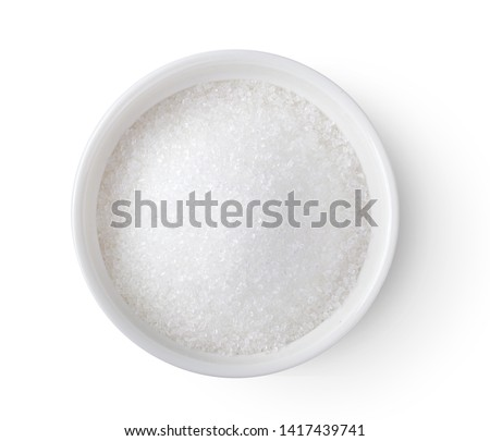 Bowl of white sugar isolated on white background, top view