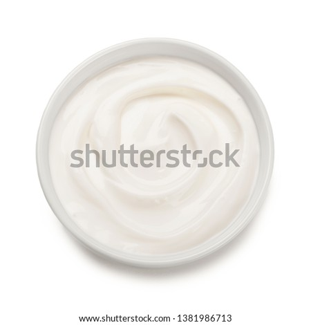 Bowl of  yogurt isolated on white background .