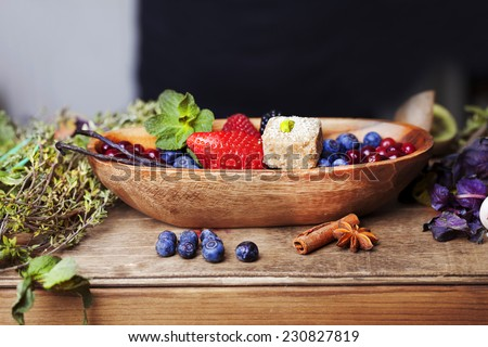 bowl with berries and mint candy in still life