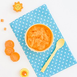 Bowl with carrot puree for baby
