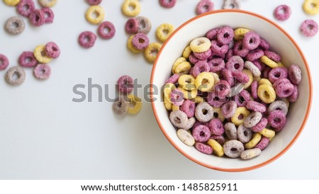 Bowl with cereals and fruit loops #1485825911