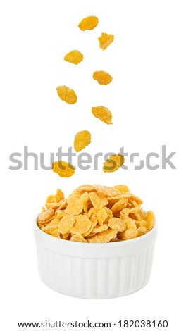 Bowl with corn flakes on the white background #182038160