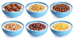 Bowl with corn pads, rings, balls, oat granola, cornflakes and yogurt isolated on white background. Cereals breakfast collection with clipping path.