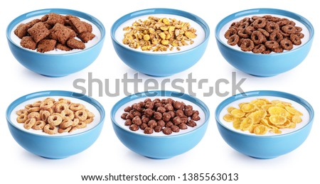 Bowl with corn pads, rings, balls, oat granola, cornflakes and yogurt isolated on white background. Cereals breakfast collection with clipping path. #1385563013