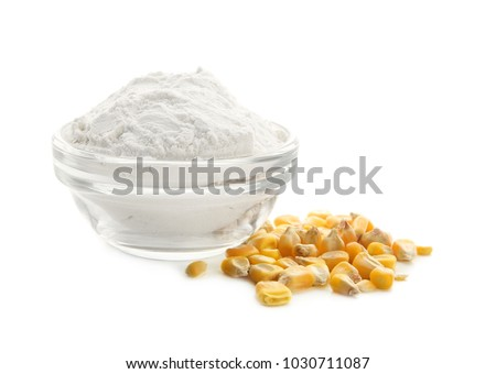 Bowl with corn starch and kernels on white background