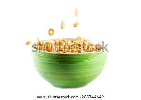 bowl with cornflakes and milk in isolated white background #265744649
