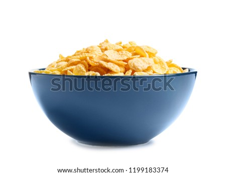 Bowl with crispy cornflakes on white background #1199183374