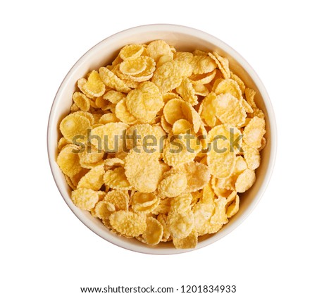 Bowl with crispy cornflakes on white background, top view #1201834933