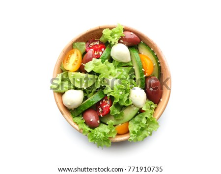 Bowl with delicious vegetable salad on white background, top view