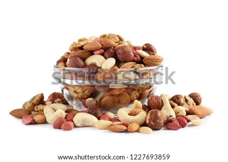 bowl with different mixed nuts isolated on white background