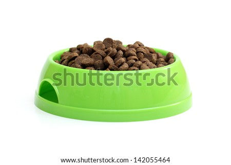 bowl with dry food for dog or cat isolated on white background