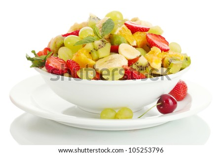 bowl with fresh fruits salad and berries isolated on white