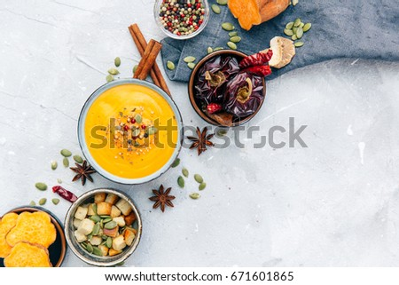Bowl with fresh homemade carrot pumpkin soup and spices. #671601865