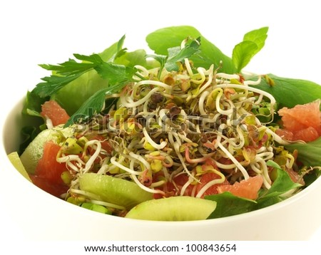 Bowl with fresh salad with vegetables and fruits