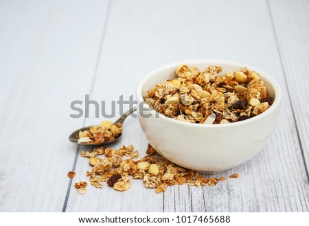 Bowl with granola  on a old wooden table Stock photo ©