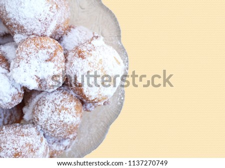 Bowl with homemade fritters, homemade fried balls on a pastel background with free space for text, flat lay #1137270749