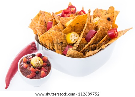 Bowl with Nachos isolated on white background