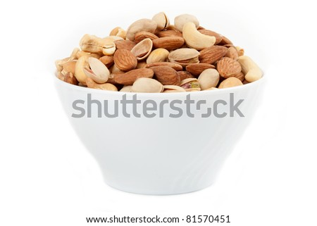 Bowl with nuts on a white background. - stock photo