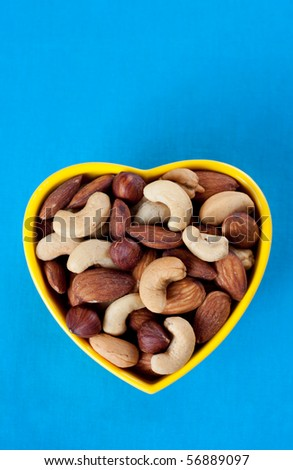 Bowl with Nuts on Blue Background