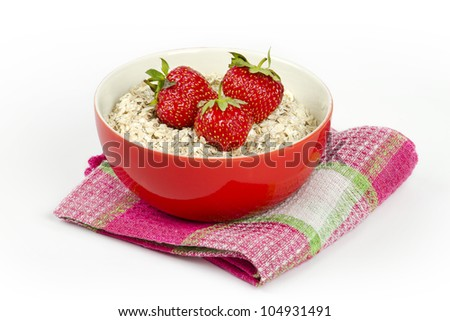 bowl with oatmeal and fresh strawberries