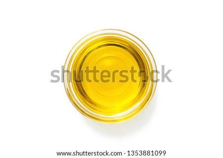 Bowl with olive oil isolated on white .