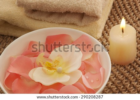 Bowl with orchid and rose petals