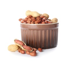 Bowl with peanuts on white background