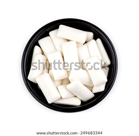 Bowl with pieces of tasty white chewing gum #249683344