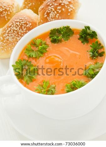 Bowl with pumpkin soup and sesame buns. Shallow dof. - stock photo