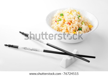bowl with rice and chopsticks